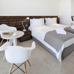 Amphora Hotel & Suites комната для гостей