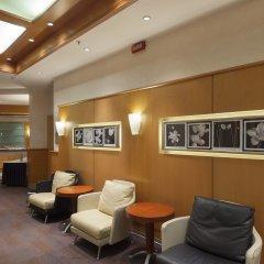 Отель NH Milano Machiavelli интерьер отеля