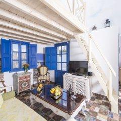 Отель Oia Sunset Villas Греция, Остров Санторини - отзывы, цены и фото номеров - забронировать отель Oia Sunset Villas онлайн комната для гостей фото 3