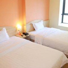 Отель 7Days Inn Xinyu Shengli Nan Road комната для гостей фото 2