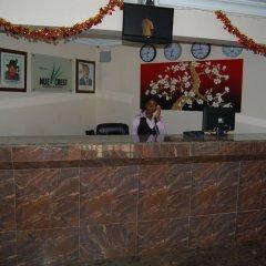 Отель Nue-Crest Hotels And Suites Нигерия, Энугу - отзывы, цены и фото номеров - забронировать отель Nue-Crest Hotels And Suites онлайн интерьер отеля фото 2