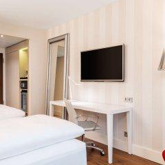 Отель NH Collection Frankfurt City удобства в номере