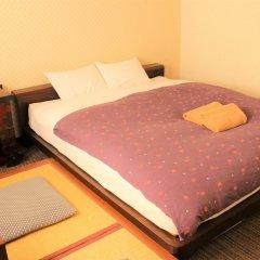 Отель K's House Tokyo Oasis Токио сейф в номере фото 2