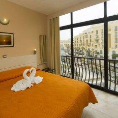 Отель Rokna Hotel Мальта, Сан Джулианс - 1 отзыв об отеле, цены и фото номеров - забронировать отель Rokna Hotel онлайн балкон