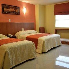 Hostalia Hotel Expo & Business Class комната для гостей