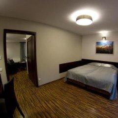Отель Apartamenty Convallis Косцелиско сейф в номере