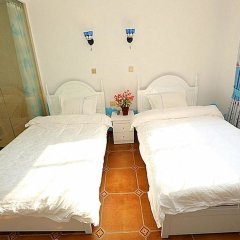 Отель Xiamen Haixi Haibian Holiday Inn комната для гостей фото 3