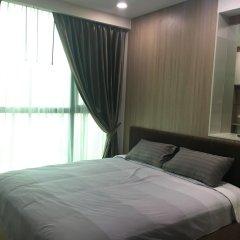 Отель Dusit Grand Condo View Pattaya Паттайя комната для гостей