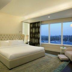 Отель Hilton Capital Grand Abu Dhabi комната для гостей фото 5