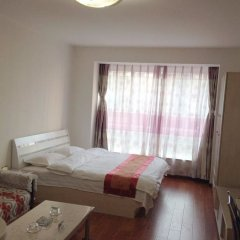 Free Town Apartment Hotel Пекин комната для гостей фото 3