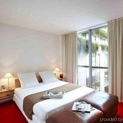 Отель La Clef Tour Eiffel (ex. Citadines Suites Arc de Triomphe) комната для гостей фото 3