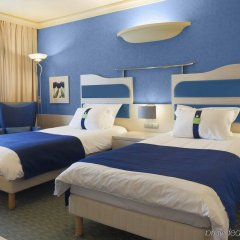 Отель Holiday Inn Attica Av. Airport West Спата комната для гостей фото 3
