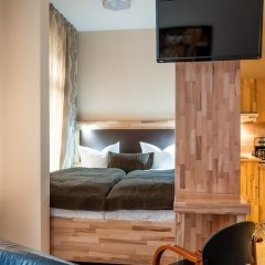 Апартаменты Karli Apartments & Suiten комната для гостей фото 3