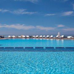 Отель Orizontes Hotel & Villas Греция, Остров Санторини - отзывы, цены и фото номеров - забронировать отель Orizontes Hotel & Villas онлайн бассейн фото 2