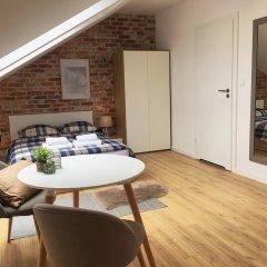 Апартаменты Blue Mandarin Apartments - Szafarnia комната для гостей фото 4