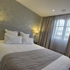 Отель Timhotel Opera Grands Magasins Париж комната для гостей фото 3