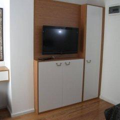 Jakaranda Hotel удобства в номере