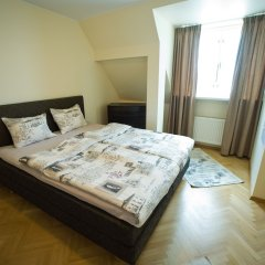 Апартаменты Oldhouse Apartments Таллин сейф в номере