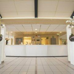 Отель Fletcher Hotel - Resort Spaarnwoude Нидерланды, Велсен-Зюйд - отзывы, цены и фото номеров - забронировать отель Fletcher Hotel - Resort Spaarnwoude онлайн интерьер отеля