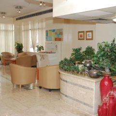 Отель Al Buhaira Hotel Apartments ОАЭ, Шарджа - отзывы, цены и фото номеров - забронировать отель Al Buhaira Hotel Apartments онлайн интерьер отеля