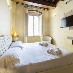 Апартаменты Piccolo Signoria Apartment Флоренция комната для гостей фото 4