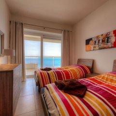 Отель Seafront Luxury Apartment With Pool Мальта, Слима - отзывы, цены и фото номеров - забронировать отель Seafront Luxury Apartment With Pool онлайн комната для гостей фото 4