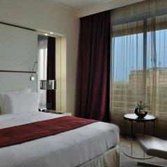 Отель Pullman Kinshasa Grand Hotel Республика Конго, Киншаса - отзывы, цены и фото номеров - забронировать отель Pullman Kinshasa Grand Hotel онлайн комната для гостей фото 4