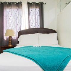 Отель Strathairn 110 by Pro Homes Jamaica Ямайка, Кингстон - отзывы, цены и фото номеров - забронировать отель Strathairn 110 by Pro Homes Jamaica онлайн комната для гостей