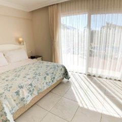 The Blue Lagoon Deluxe Hotel комната для гостей