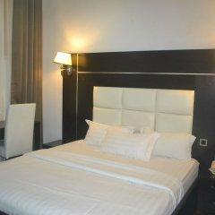 Отель Mac Dove Lounge & Suites ltd комната для гостей фото 2