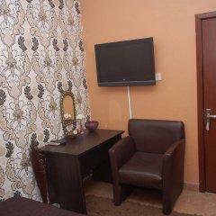Отель Dcove Hotel & Suites Нигерия, Лагос - отзывы, цены и фото номеров - забронировать отель Dcove Hotel & Suites онлайн удобства в номере фото 2