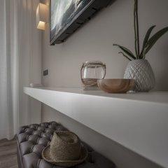 Отель Suite Litoraneo Римини сейф в номере