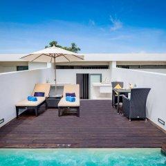 Отель Relax @ Twin Sands Resort and Spa бассейн фото 2