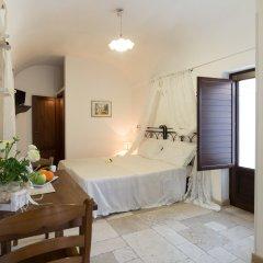 Отель Trulli Family Альберобелло комната для гостей фото 3