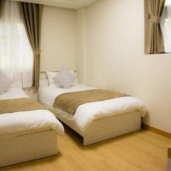 Отель Gloryinn Южная Корея, Сеул - 1 отзыв об отеле, цены и фото номеров - забронировать отель Gloryinn онлайн комната для гостей фото 2