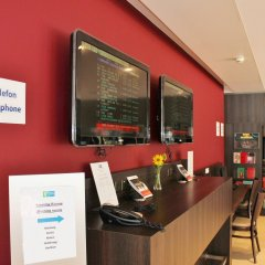Отель Holiday Inn Express Zurich Airport Швейцария, Рюмланг - 1 отзыв об отеле, цены и фото номеров - забронировать отель Holiday Inn Express Zurich Airport онлайн банкомат