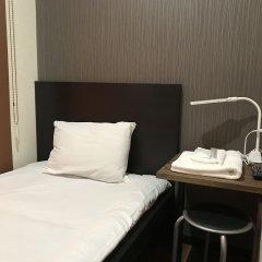 Отель Stay30 - Caters to Men Япония, Хаката - отзывы, цены и фото номеров - забронировать отель Stay30 - Caters to Men онлайн комната для гостей фото 5