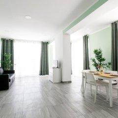 Отель Ducassi Suites Rooftop Pool Beach Club & Spa комната для гостей