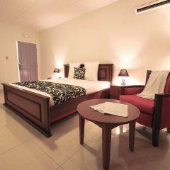 Отель L'Adagio Габон, Либревиль - отзывы, цены и фото номеров - забронировать отель L'Adagio онлайн комната для гостей фото 3