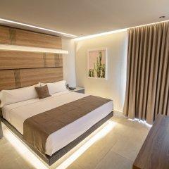 Отель Heat Suites - Adults Only комната для гостей фото 3