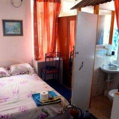 Отель Le Bamboo сейф в номере