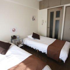 Отель Pure Tenjin Фукуока сейф в номере