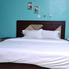 Отель Petesville Hotel Calabar Нигерия, Калабар - отзывы, цены и фото номеров - забронировать отель Petesville Hotel Calabar онлайн комната для гостей фото 2