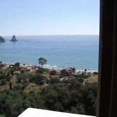 Отель Skyfall Греция, Корфу - отзывы, цены и фото номеров - забронировать отель Skyfall онлайн пляж фото 2
