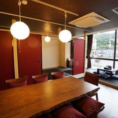 Отель Japanese Condominium UNO Ито в номере