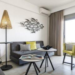 Апартаменты Mirage City Apartments Родос комната для гостей фото 3
