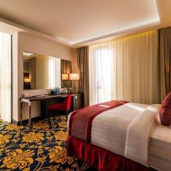 Отель Ramada and Suites by Wyndham Yerevan комната для гостей