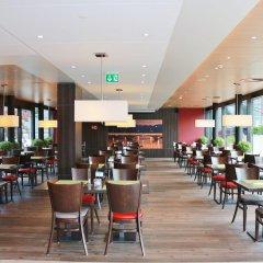 Отель Holiday Inn Express Zurich Airport Швейцария, Рюмланг - 1 отзыв об отеле, цены и фото номеров - забронировать отель Holiday Inn Express Zurich Airport онлайн гостиничный бар