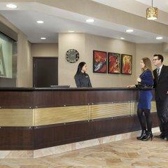 Отель Acclaim Hotel Calgary Airport Канада, Калгари - отзывы, цены и фото номеров - забронировать отель Acclaim Hotel Calgary Airport онлайн интерьер отеля