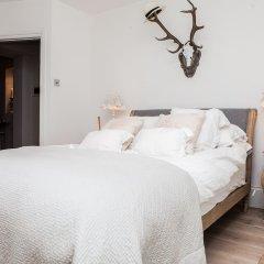 Отель Stylish 2 Bedroom Garden Apartment in Notting Hill Великобритания, Лондон - отзывы, цены и фото номеров - забронировать отель Stylish 2 Bedroom Garden Apartment in Notting Hill онлайн комната для гостей фото 2